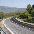 Stock Photo: Mountain road with dangerous curves