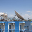Satellite Dishes on the top of Roofs — Stock Photo #12080822