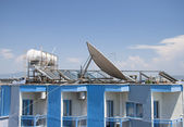 Satellite Dishes on the top of Roofs — Stock Photo