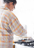 Beautiful Young Woman cooking — Stock Photo
