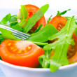 Foto de Stock  : Fresh salad with tomatoes and rucola