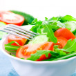 Fresh salad with tomatoes, rucola and cucumbers — Stock Photo