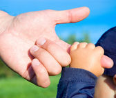 Trust family hands of child son and father — Stock Photo
