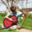 Music student playing the guitar outdoors — Stock Photo #10750398
