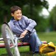 Young boy with bicycle relaxing outdoors — Stock Photo #10947594
