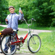 Young boy with bicycle with clear water relaxing outdoors — Stock Photo #11052156