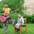 Two funny boys music student singing and playing the guitar outd — Foto de Stock