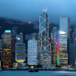 Hong Kong skyline at night against peak Victoria - Stock Photo