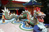 Old Dragon on oriental temple roof — Stock Photo