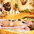 Woman getting stone therapy massage . - ストック写真