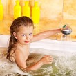 Stock Photo: Child washing in bubble bath .