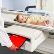 Stock Photo: Child patient in x-ray room.