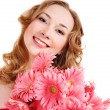 Stock Photo: Happy young woman holding flowers.