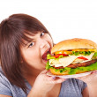 Woman eating hamburger. — Stock Photo #11295314