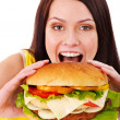 Woman holding hamburger. — Stock Photo #11295320