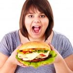 Woman eating hamburger. — Stock Photo #11295329
