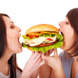 Women eating hamburger. — Stock Photo #11295333