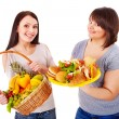 Women choosing between fruit and hamburger. — Стоковая фотография