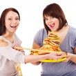 Woman holding fast food and measuring tape. — Stock Photo #11295344