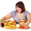 Woman eating fast food. — Stock Photo #11295351