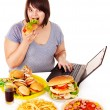 Woman eating junk food. — Stock Photo