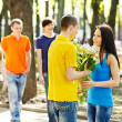 Couple of teenager on date outdoor. — Stock Photo #11295432