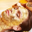 Stock Photo: Womgetting facial mask .