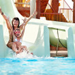 Child with mother on water slide at aquapark. — Stock Photo #11295738