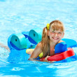 Children  in swimming pool. - Stock Photo