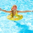 Little girl in swimming pool. — Stock Photo #11295805