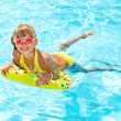 Little girl in swimming pool. — Stock Photo #11295807