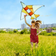 Child flying kite outdoor. — Stock Photo