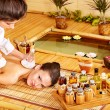 Stock Photo: Womgetting herbal compress massage.