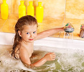 Child washing in bubble bath . — Fotografia Stock