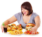 Donna mangiare fast food. — Foto Stock