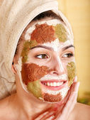 Woman with clay facial mask. — Stock Photo