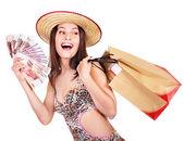 Frau mit Geld und Einkaufstasche. — Stockfoto