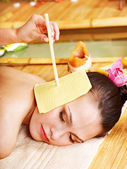 Woman getting massage with ear candle . — Stock Photo