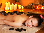 Woman getting stone therapy massage . — Stock fotografie