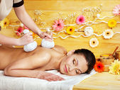 Woman getting herbal ball massage. — Stock Photo