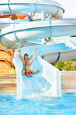 Child with mother at aquapark. — Stock Photo