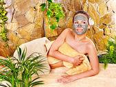 Girl having clay facial mask. — Stock Photo