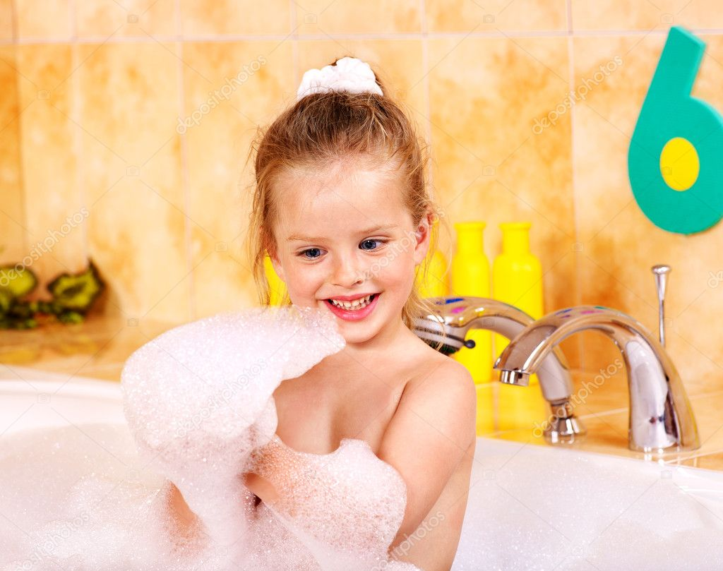 Happy child soaking in bubble bath . — Stock Photo #11294659