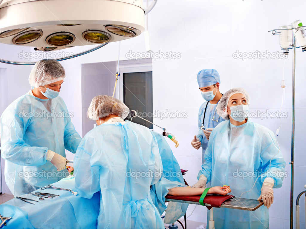 Team surgeon at work in operating room. — Stock Photo #11295059