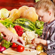 Child with vegetable on kitchen. - Stock Photo