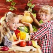 Child with vegetable on kitchen. — Stock Photo #11831102