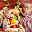 Child with vegetable on kitchen. — Stock Photo
