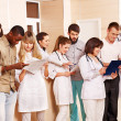 Group doctors at reception in hospital. — Stock Photo