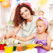 Child girl and teacher painting in school — Stock Photo #11831771