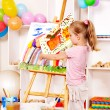 Child painting at easel in school — Stock Photo #11831814
